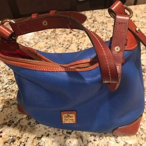"Dooney and Bourke handbag 6""w x 8-1/2""h x 13"" l"